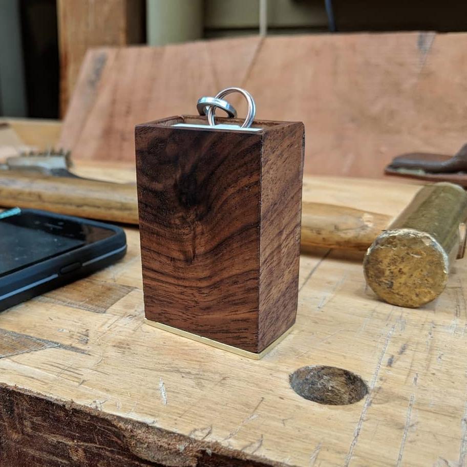 a small walnut box with brass bottom